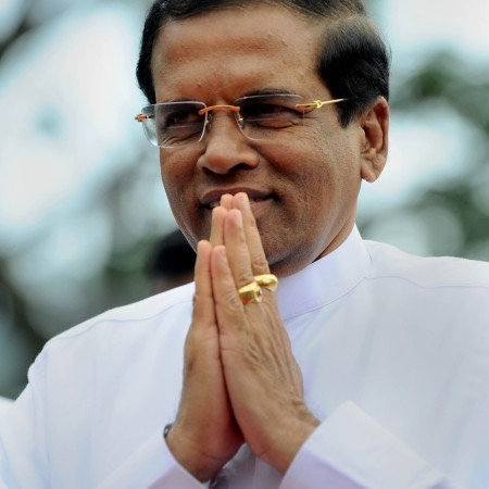 Sri Lankan President Maithripala Sirisena gestures as he arrives to address the nation from outside of the Buddhist Temple of Tooth in the central town of Kandy on January 11, 2015. Sri Lanka's new government on January 11 accused toppled strongman Mahinda Rajapakse of having tried to stage a coup to cling to power after losing last week's presidential election. AFP PHOTO/ Ishara S. KODIKARA