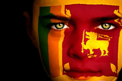 Portrait of a boy with the flag of Sri Lanka painted on his face