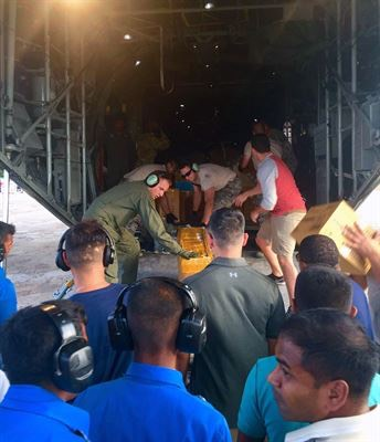 U.S. Military members and the Sri Lankan Air Force work together to unload medical supplies from a U.S. Air Force C-130 aircraft during Pacific Angel (PACANGEL) 16-3 in Jaffna, Sri Lanka, Aug. 13, 2016. PACANGEL is a multilateral humanitarian assistance/civil military operation, which improves military-to-military partnerships in the Pacific while also providing medical health outreach, civic engineering projects and subject matter exchanges among partner forces. (Photo by Senior Airman Brittany Chase)