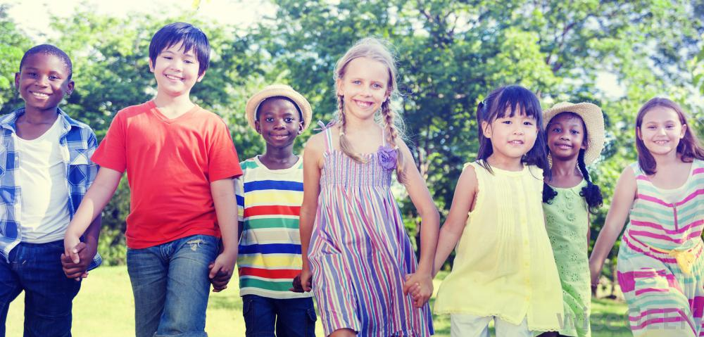 children-holding-hands-outdoors