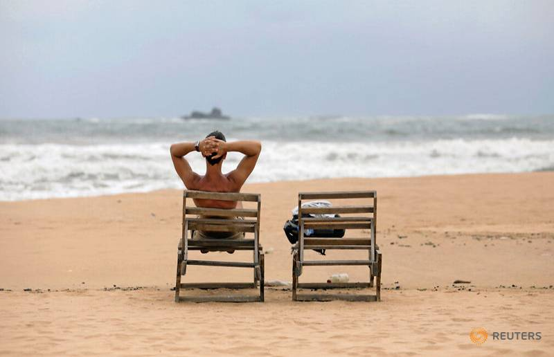 a-tourist-rests-on-a-beach-near-hotels-in-a-tourist-area-in-bentota-1